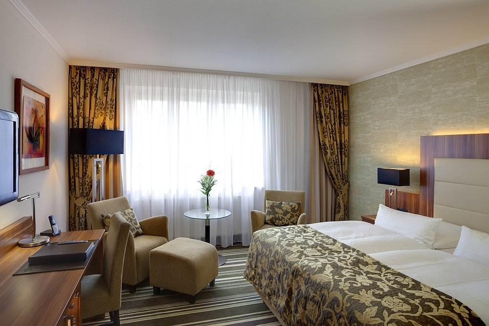 Mehrtägiges Meeting? Die komfortablen Hotelzimmer sorgen für eine gute Nachtruhe.